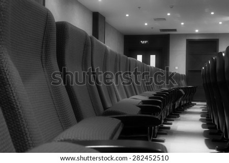 chairs in a theatre, closeup of photo