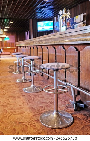 Chairs in row in bar  - stock photo
