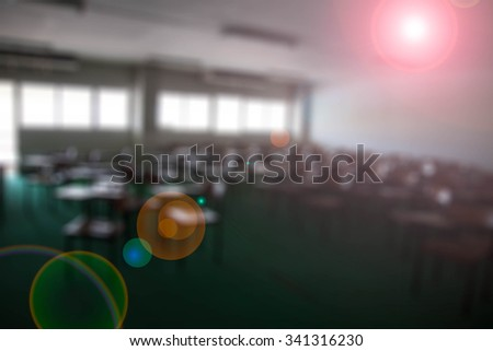 chairs in the big classroom blurred Lens flare background - stock photo