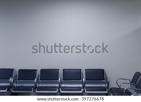 Chairs in the corner for a waiting in an airport. Blank space on the wall. Airport Pulkovo