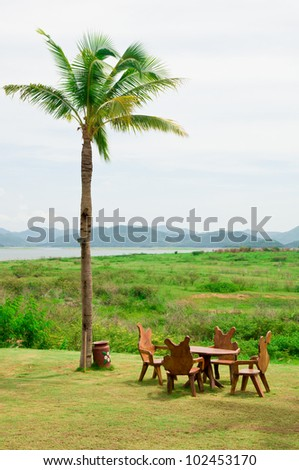 Chairs in the green garden - stock photo