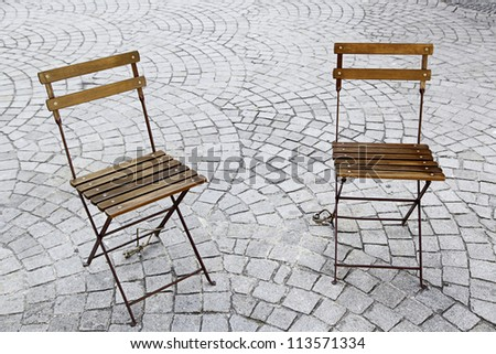 Chairs in the park, two chairs in a square in a town of Portugal, Europe