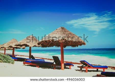 chairs on exotic tropical white sand beach