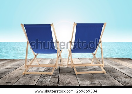 chairs on pier and sea  - stock photo