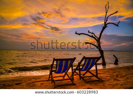 Chairs on the beach at sunset