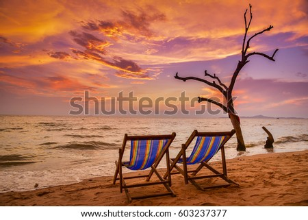 Chairs on the beach at sunset.