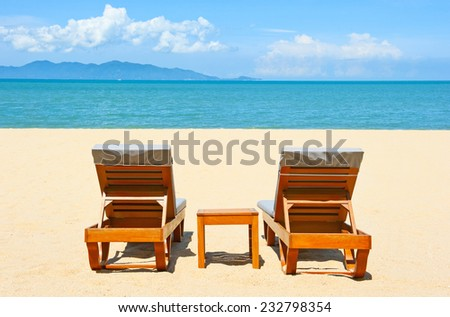 Chairs on the beach near sea - stock photo