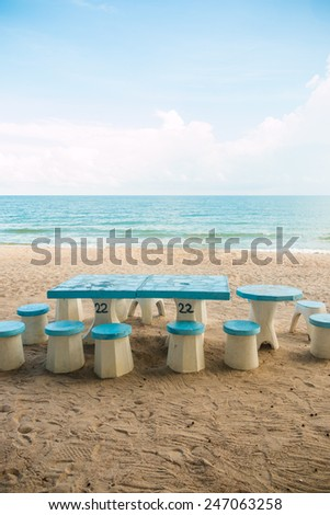chairs on the beach with blue-sky - stock photo