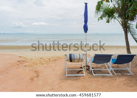 Chairs on the sand beach near the sea. Summer holiday and vacation concept