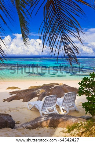 Chairs on tropical beach at Seychelles - vacation background - stock photo