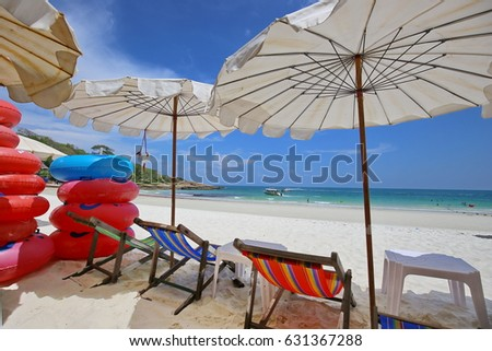 Chairs with umbrella at beach