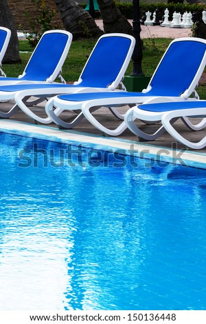 chaise longue by the pool - stock photo