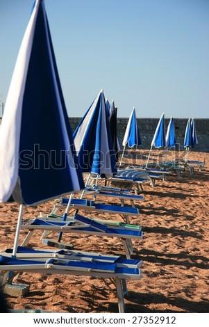 Chaise longue on beach, Montenegro - stock photo