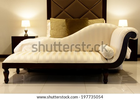 Chaise Lounge / Cream Chaise Lounge in Bedroom - stock photo