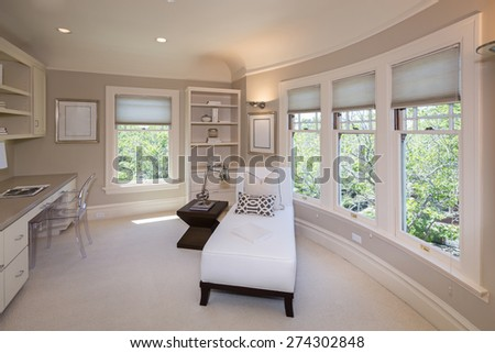 Chaise Lounge with view window and decoration in luxurious home plus transparent chair.  - stock photo