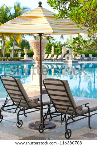chaise lounges near  pool