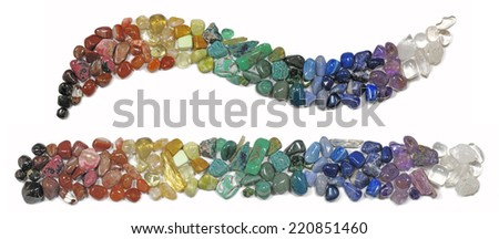 Chakra Healing Crystals  -   Multicolored chakra crystals in both a curve formation and a straight line on a white background  - stock photo