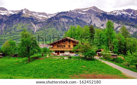 Chalet in swiss Alps - stock photo