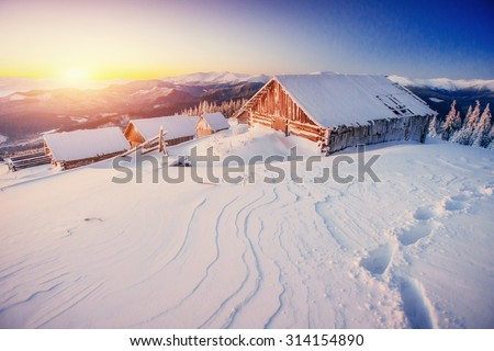 chalet in the mountains - stock photo