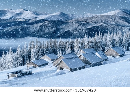 chalet in the mountains. Carpathian, Ukraine, Europe. Bokeh light effect, soft filter. Instagram toning effect. - stock photo