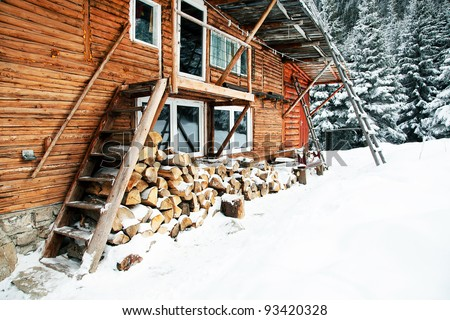 Chalet in winter - stock photo