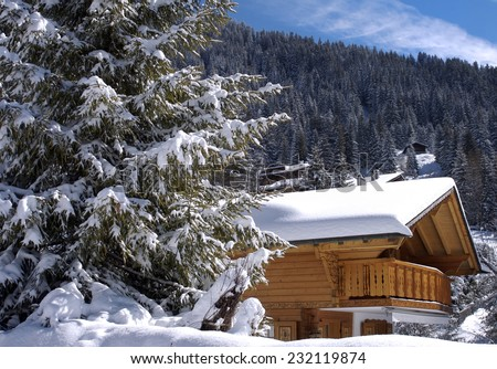 chalet in winter in the swiss Alps - stock photo