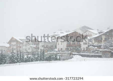 Chalets, during a snowstorm, in Mals, Northern Italy