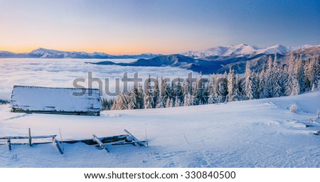 chalets in the mountains at sunset. Carpathian, Ukraine, Europe. - stock photo
