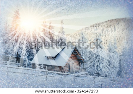 chalets in the mountains at sunset. Winter greetings - stock photo