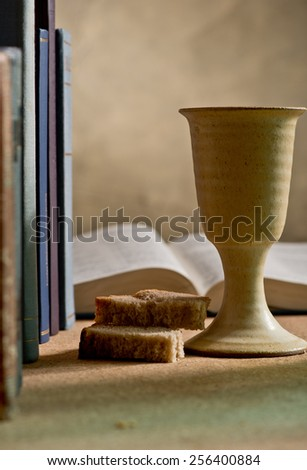 chalice of wine and bible - stock photo