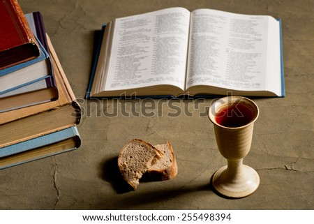 chalice of wine and bread  - stock photo