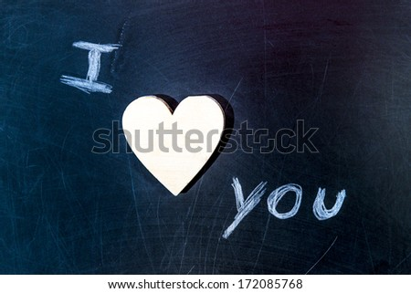 chalk board with i love you text, with wooden heart - stock photo