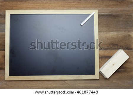 Chalk,Chalk board and eraser on wooden background