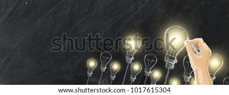 Chalk drawing bulb electric concept design with hand on black background for website and timeline,Light bulbs and chalk board with copy space for text.