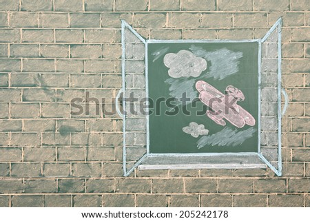 Chalk drawing of airplane in open window - stock photo