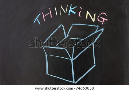 Chalk drawing - Thinking outside the box - stock photo