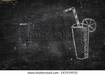 Chalk on black board: Glass of juice - stock photo