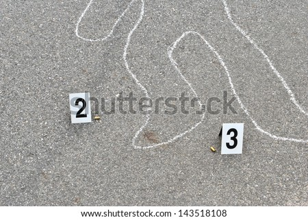 Chalk outline of human body on the street - stock photo