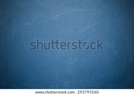 Chalk rubbed out on blueboard - stock photo