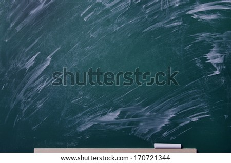 Chalk rubbed out on board. Blank chalkboard, blackboard texture with copy space. - stock photo