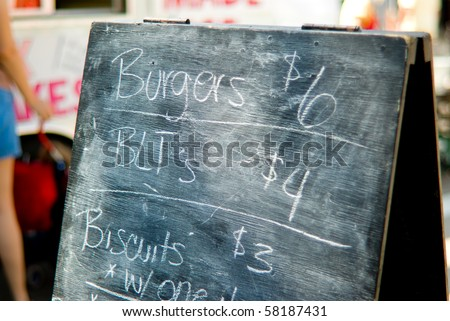 Chalk sign in front of  a street vendor - stock photo