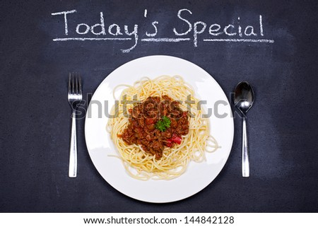 Chalkboard advertising the daily special of Spaghetti Bolognese - stock photo