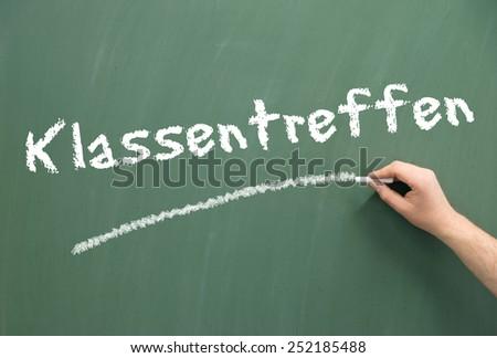 Chalkboard and the german word class reunion / class reunion - stock photo