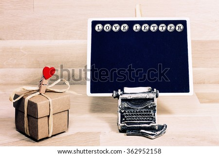 chalkboard and typewriter with love letter word,Valentine day February 14 - stock photo