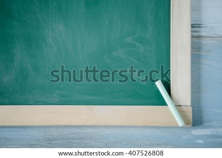 Chalkboard background  - Blackboard, chalkboard, green chalk board holding chalk, texture for text, wood background