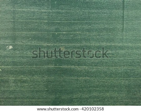Chalkboard / blackboard green. Empty blank with copy space for chalk text. Used feel with chalk traces and great texture. - stock photo