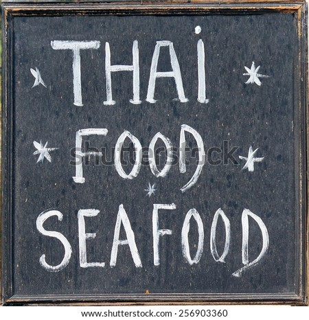 chalkboard  from a thai restaurant  - stock photo