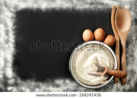chalkboard of flour spoons eggs and free space  - stock photo