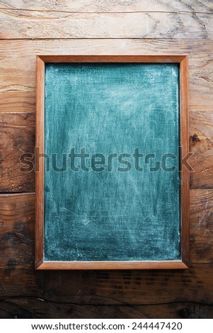 Chalkboard on wooden background - stock photo