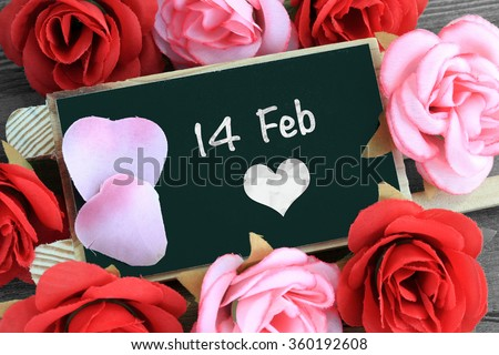 chalkboard sign showing 14 February, Valentine's day - stock photo